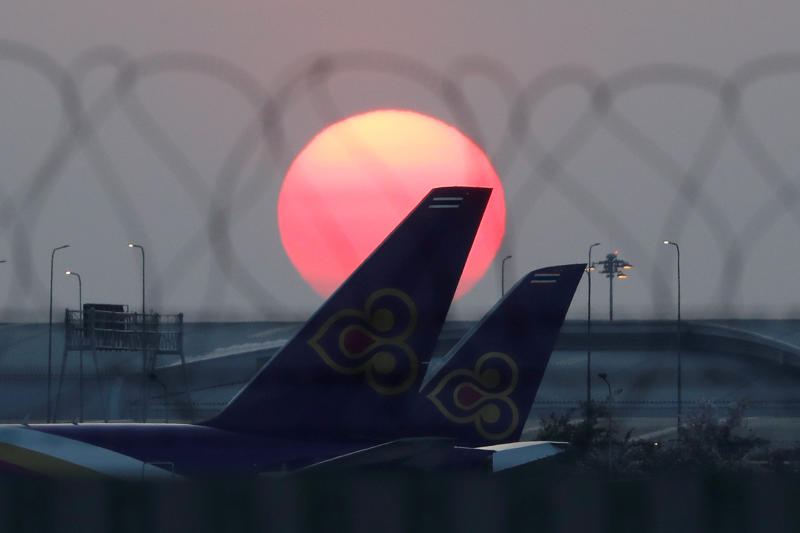 Thai Airways International airplanes are parked on the tarmac of Suvarnabhumi airport on March 25, 2020. (Reuters file photo)