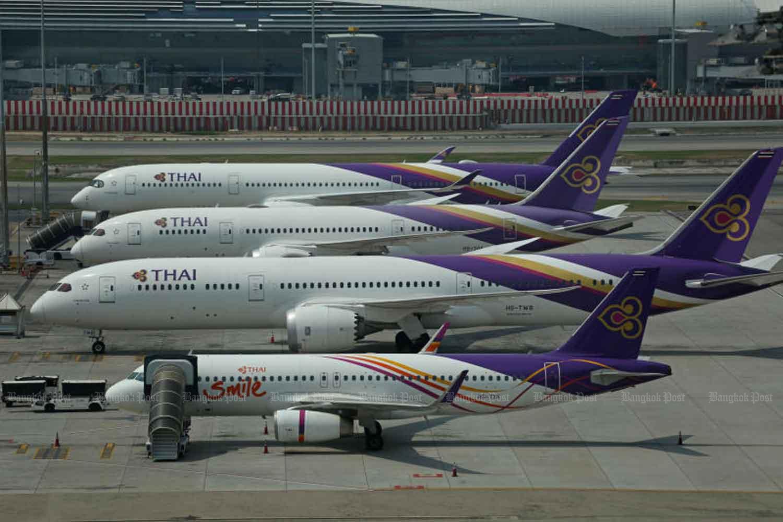 Thai Airways International and THAI planes are seen at Suvarnabhumi airport. (Bangkok Post file photo)