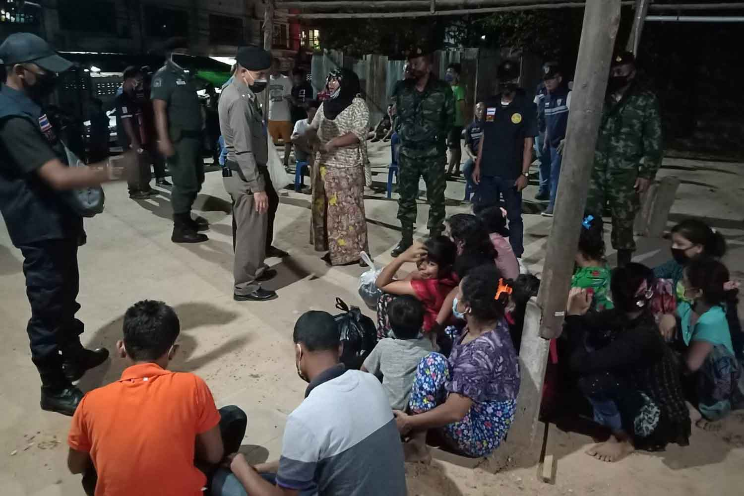 The 12 illegal Rohingya migrants, including two children, at Mae Sot police station in Tak after being arrested for illegal entry on Tuesday night. (Photo: Assawin Pinitwong)