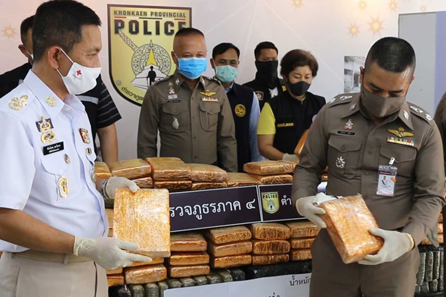 Police examine the seized marijuana during a media briefing in Khon Kaen on Thursday. (Photo: Chakrapan Nathanri)