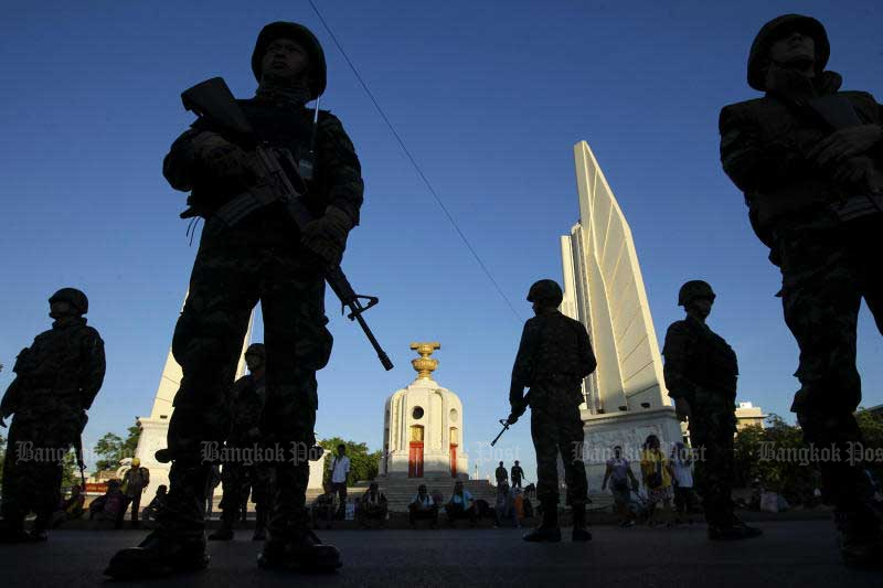Soldiers stand guard blocking potential anti-coup protesters at Democracy Monument in Bangkok on May 23, 2014, one day after the coup. (Photo by Patipat Janthong)