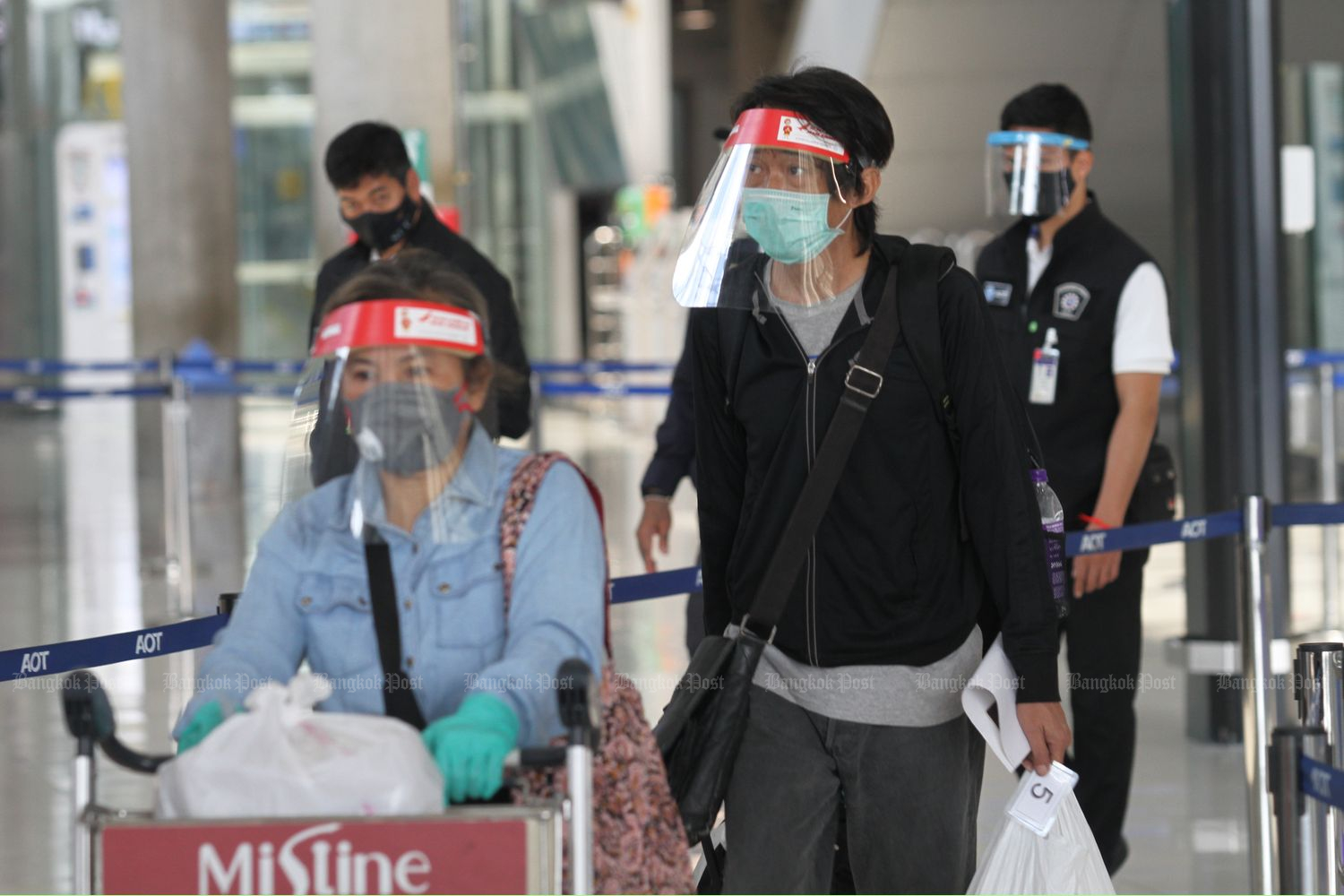 Some of the 35 Thais returning home from India are processed at Suvarnabhumi airport upon landing on Wednesday afternoon. All but one were sent to state quarantine at Chor Cher - The Green Residence hotel in Samut Prakan province. The other with a slight fever was sent to a hospital. (Photo by Nutthawat Wicheanbut)
