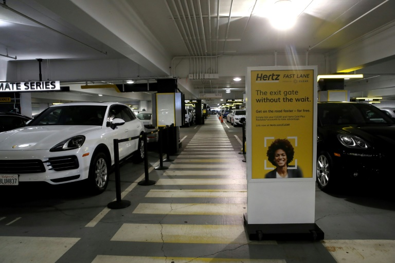 Cars sit idle at the Hertz Rent-A-Car rental lot at San Francisco International Airport in California