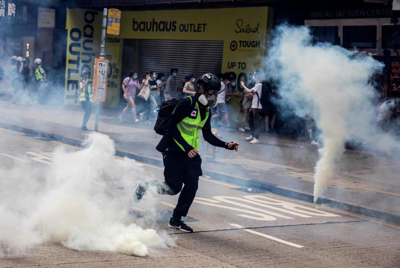 Police fire tear gas on protesters during protests against a proposal to enact a new security legislation in Hong Kong on Sunday. (AFP photo)