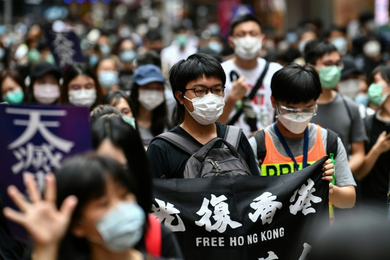 Thousands of Hong Kong protesters are tear-gassed by police