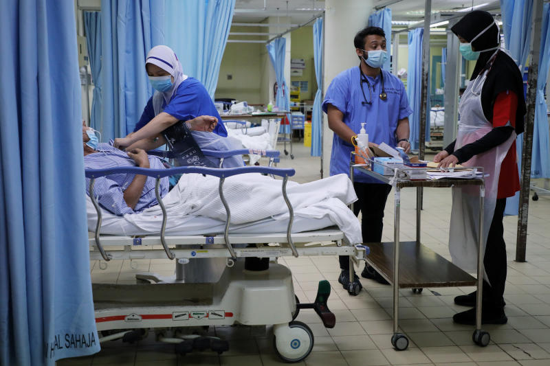 Malaysian doctor Muhammad Syahidd Al Hatim works at the Emergency Department in the Kuala Lumpur Hospital, during the last day of Ramadan, amid the coronavirus disease outbreak, in Kuala Lumpur, Malaysia on Saturday. (Reuters photo)