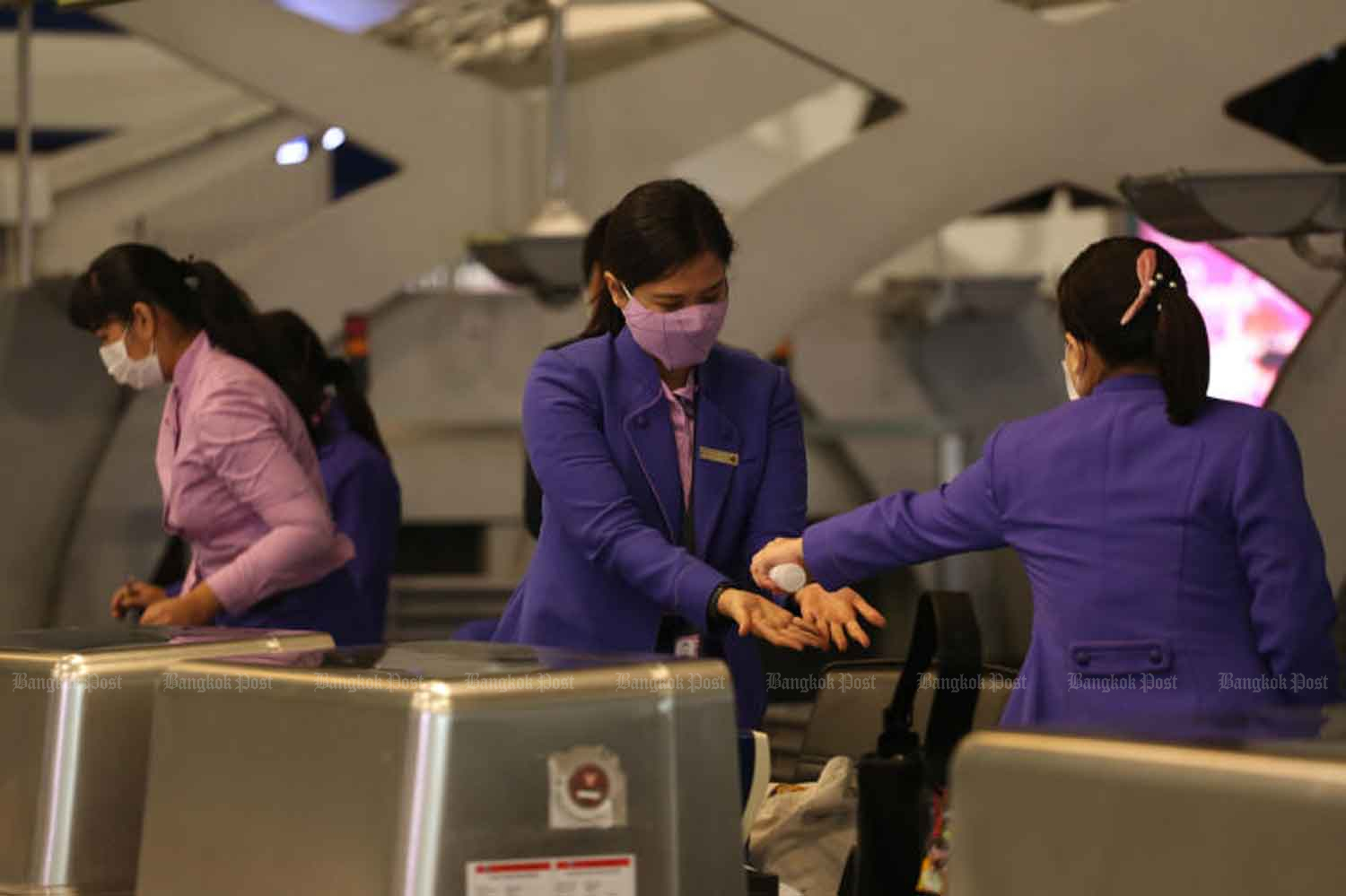 Thai Airways International staff work at Suvarnabhumi airport in Samut Prakan province on Tuesday as the management of the airline files for bankruptcy with the Central Bankruptcy Court. (Photo: Varuth Hirunyatheb)