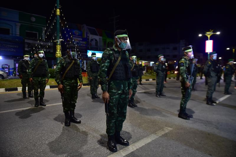 This photo taken on April 3, 2020 shows soldiers wearing protective gear on an empty road in Thailand's southern province of Narathiwat, before a night of enforcing a nationwide night curfew aimed at stemming the spread of the Covid-19 coronavirus. (AFP)