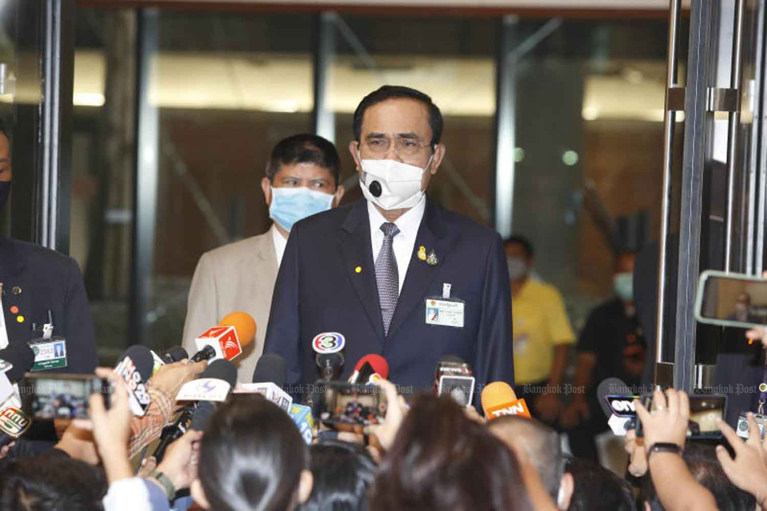 Prime Minister Prayut Chan-o-cha is leaving the parliament in Bangkok after a debate on the government's financial plan to handle Covid-19 impacts on Thursday. (Photo: Pattarapong Chatpattarasill)
