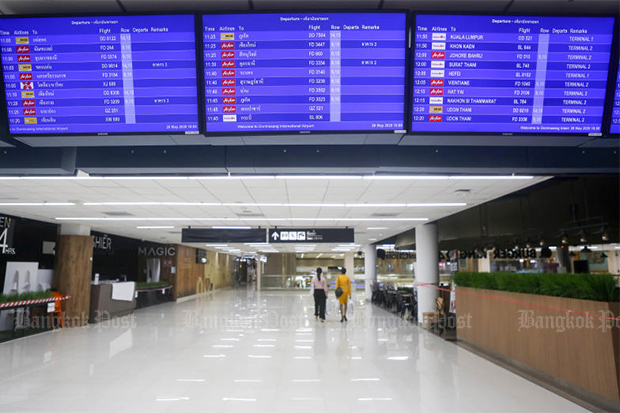 Airline staff members walk through the empty Don Mueang airport on May 26. Thailand officially recorded no foreign tourist arrivals in April, a figure that will be matched in May as the country remains closed to international flights. (Photo by Pattarapong Chatpattarasill)