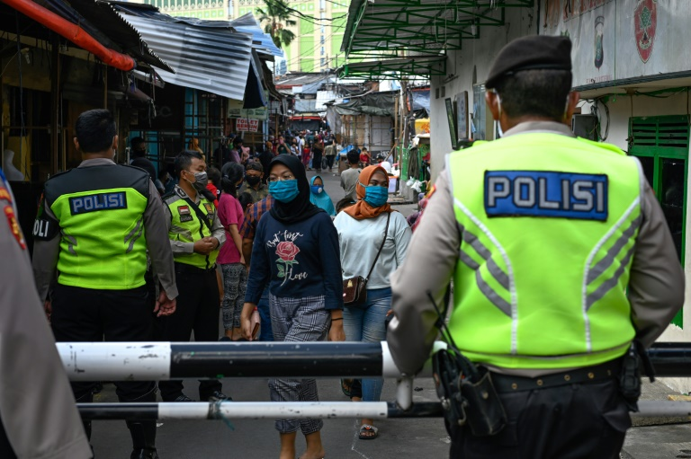 Alongside police and troops overseeing enforcement measures, provincial leaders are running their own zealous campaigns to fight the virus in Indonesia.