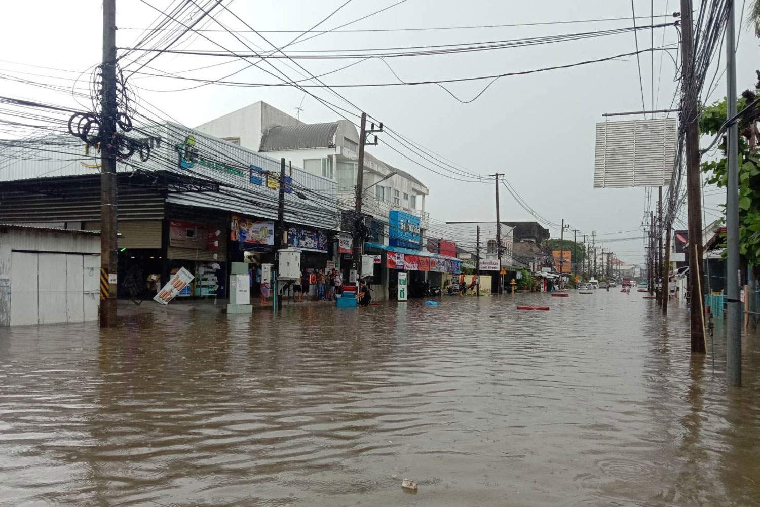 Tha Khraeng intersection on Sakdidet Road is flooded after two hours of heavy rain in Muang district of Phuket on Saturday morning. (Photo: Achadtaya Chuenniran)