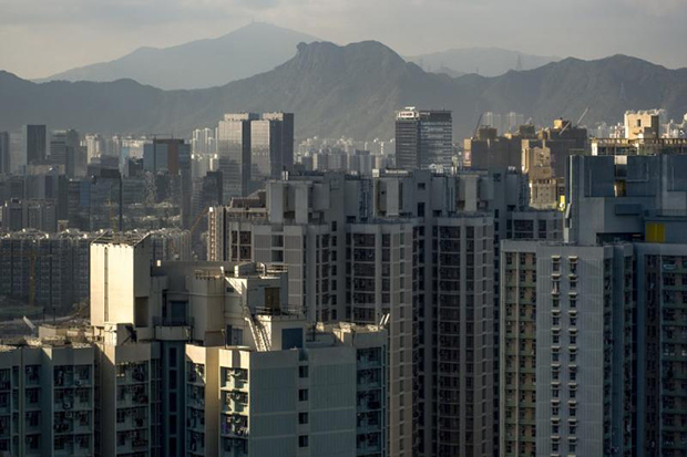 Aerial view of residential buildings in front of Lion Rock in the Yau Tong area, east of the Kowloon Peninsula in Hong Kong. (South China Morning Post photo)