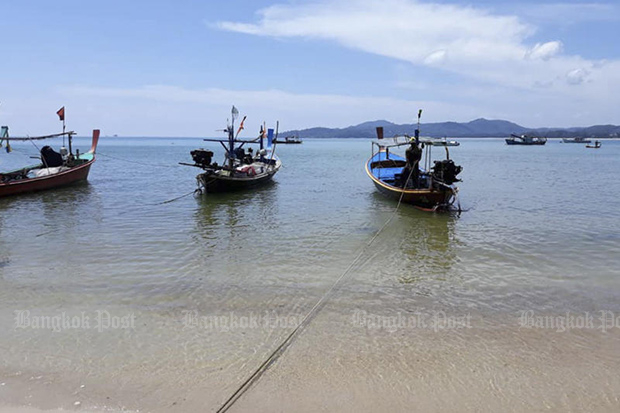 Coastal fishing boats rest off Bang Tao beach on Phuket island on Jan 20, 2020. (Photo by Achadtaya Chuennirun)