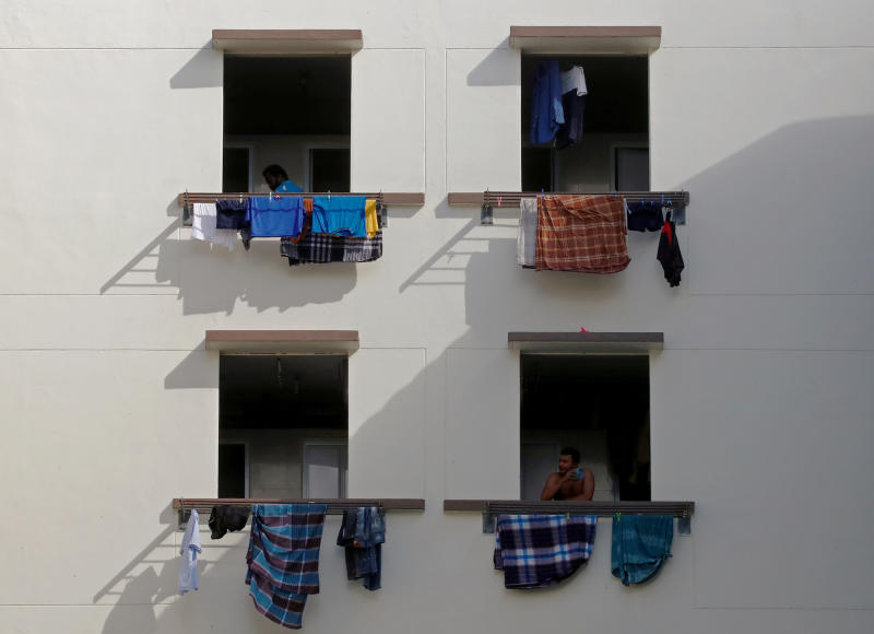 Migrant workers look out of windows in a dormitory, amid the coronavirus disease outbreak in Singapore May 15, 2020. (Reuters file photo)