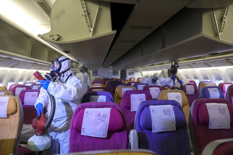 Members of a Thai Airways crew disinfect the cabin of an aircraft during a procedure to prevent the spread of the coronavirus at Bangkok's Suvarnabhumi International Airport on Jan 28, 2020. (Reuters file photo)