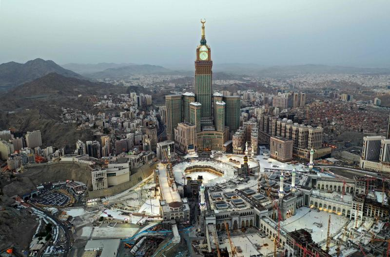 This picture taken on May 24, 2020 during the early hours of Eid al-Fitr, the Muslim holiday which starts at the conclusion of the holy fasting month of Ramadan, shows an aerial view of Saudi Arabia's holy city of Mecca, with the Abraj al-Bait Mecca Royal Clock Tower overlooking the Grand Mosque and Kaaba in the centre. (AFP photo)
