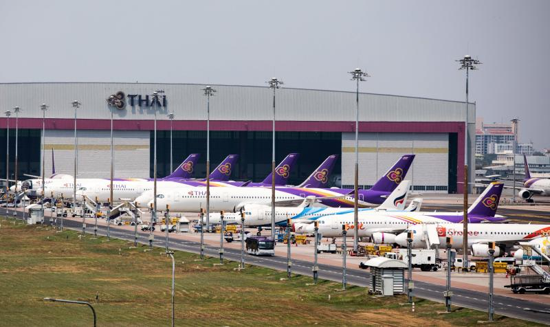 Thai Airways aircraft are parked on the tarmac at Suvarnabhumi Airport in Bangkok on March 25, 2020 as the airline suspended international flights due to the Covid-19 coronavirus. (AFP file photo)