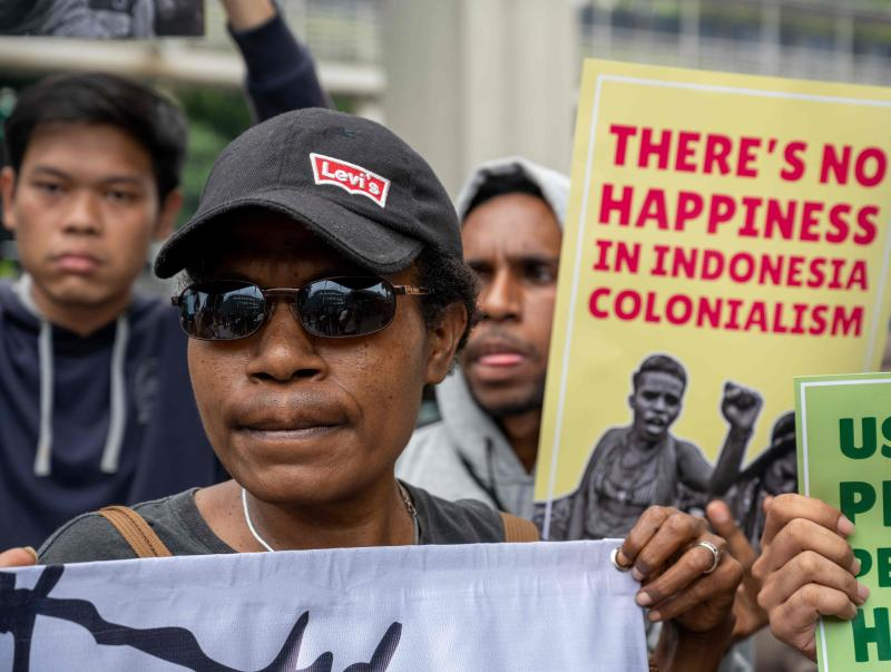 Activists display placards at a rally in front of the Netherlands embassy in Jakarta on March 12, 2020, to draw awareness to Indonesia's Papua region, as Dutch King Willem-Alexander and Queen Maxima visit the Southeast Asian nation. (AFP file photo)