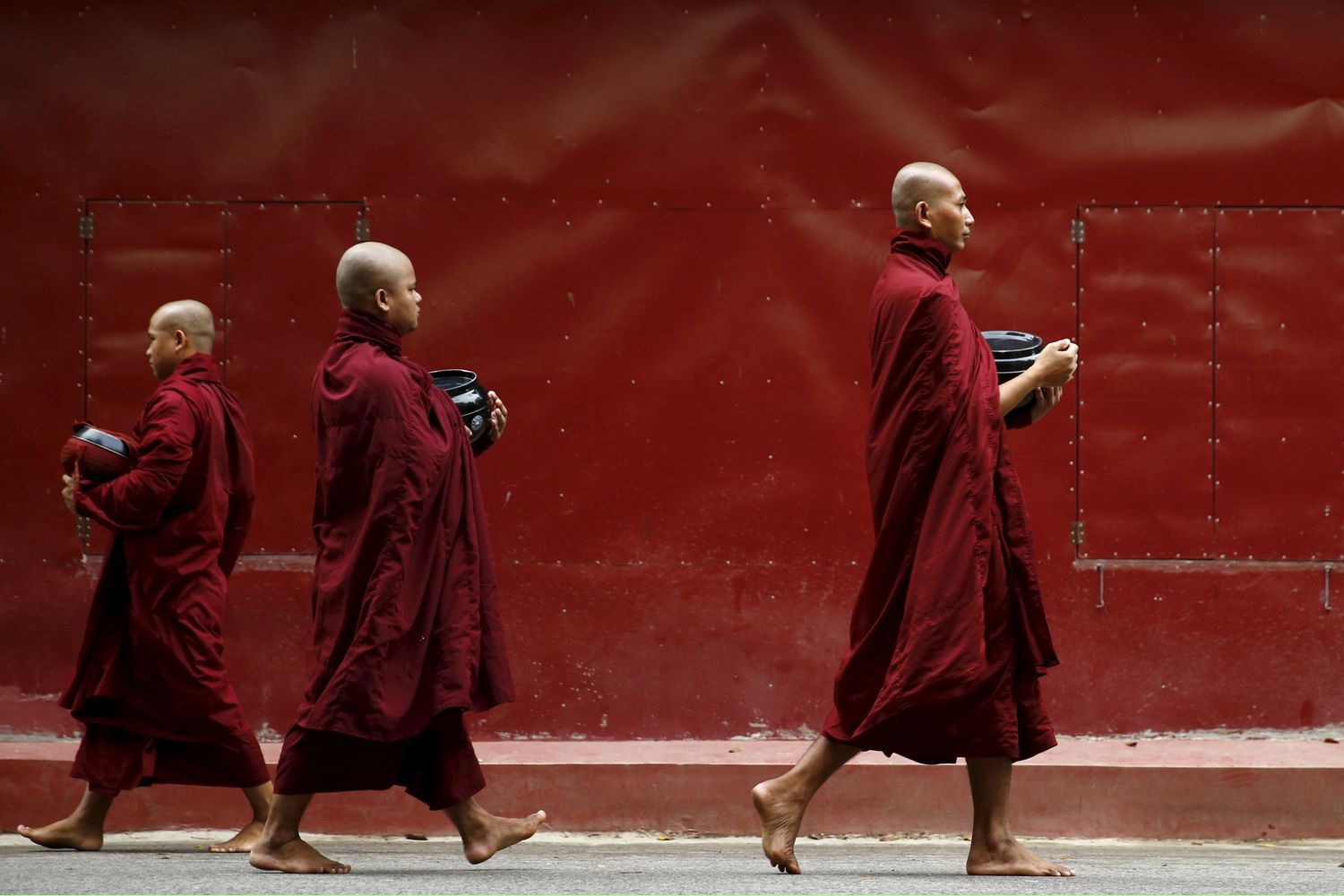 Buddhist monks walk inside the Masoyein monastery complex in Mandalay in October 2015. (Reuters photo)