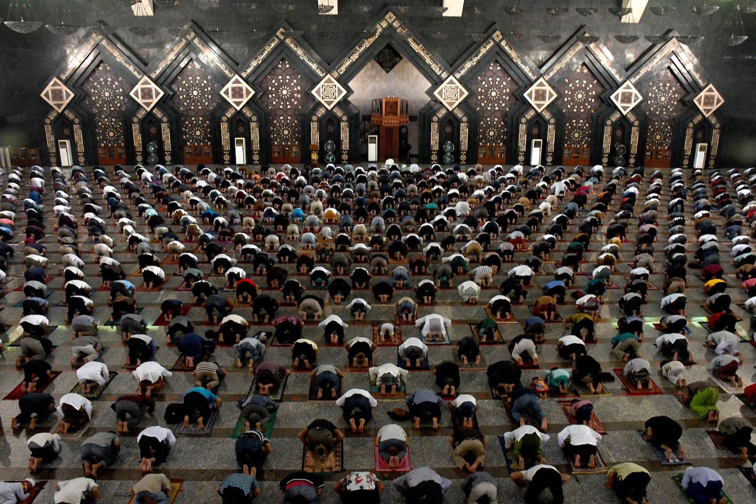 Worshippers attend prayers at the Attin Mosque in Jakarta, where places of worship opened on Friday for the first time in three months. (AFP)