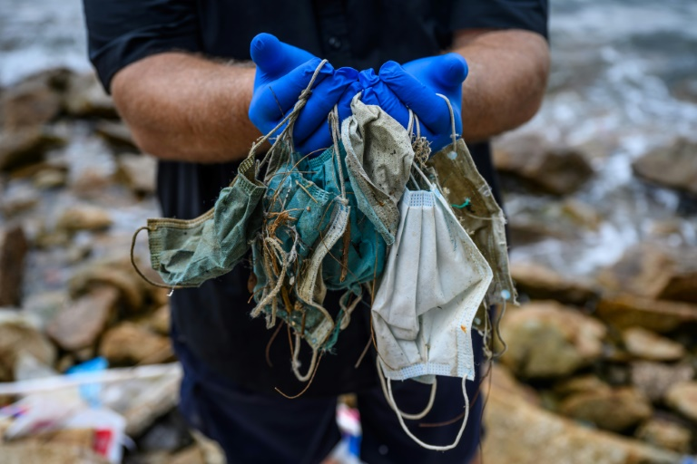 Face masks are washing up on Hong Kong's shores in increased quantities.