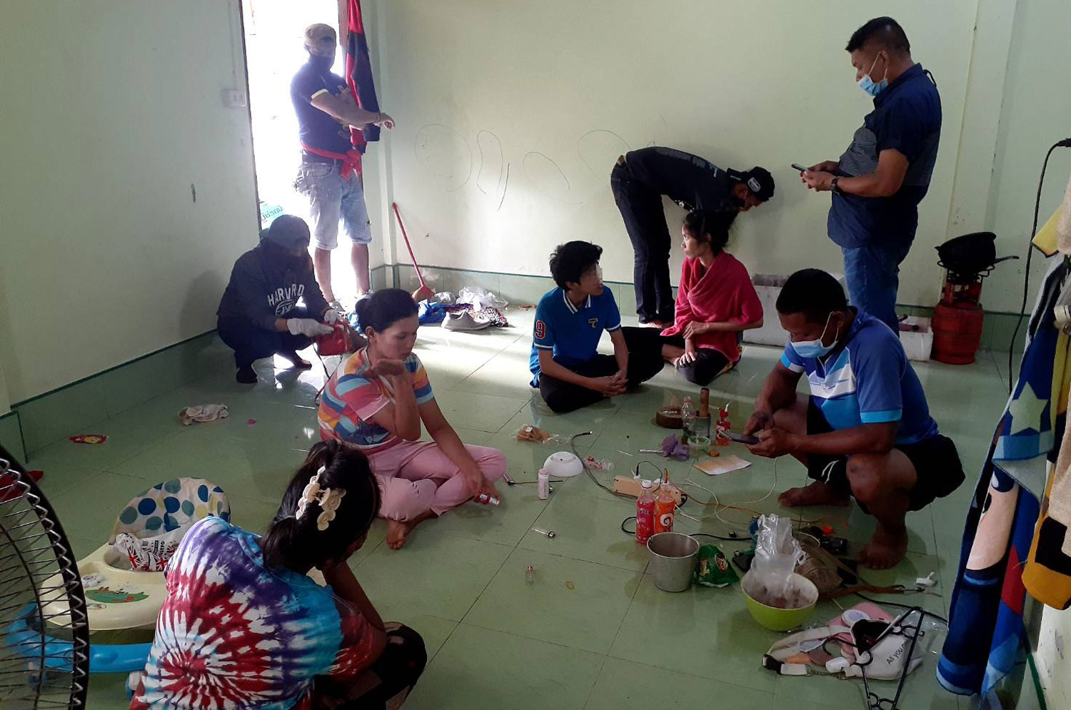 Officials question four young women and a male teenager found taking methamphetamine inside a rented house in Thepha district of Songkhla on Saturday. (Photo: Assawin Pakkawan)