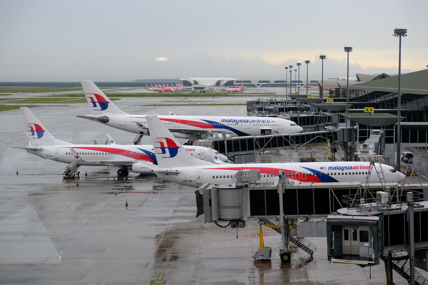 Malaysia Airlines aircraft stand on the tarmac at Kuala Lumpur International Airport on May 13. (Bloomberg Photo)