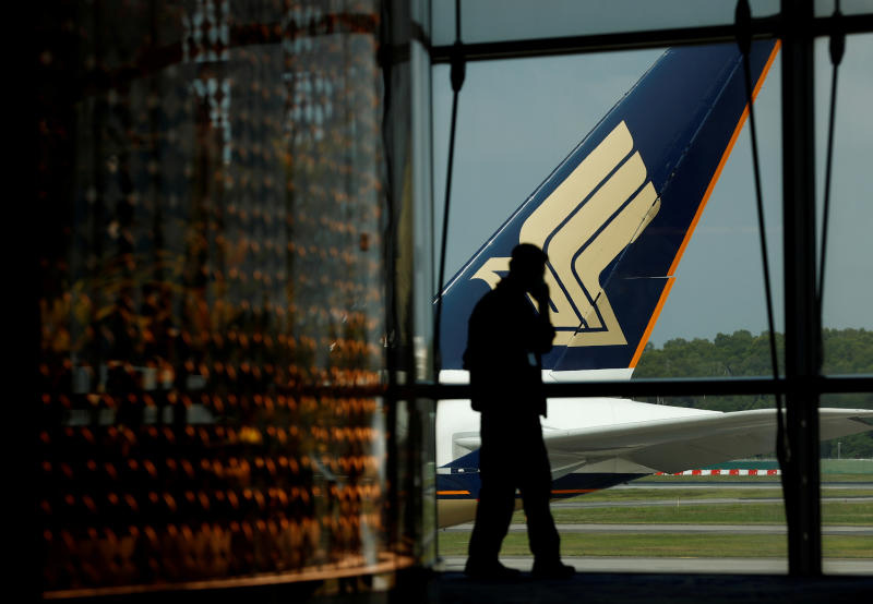 A Singapore Airlines plane sits on the tarmac at Changi Airport on March 11, 2020. (Reuters photo)