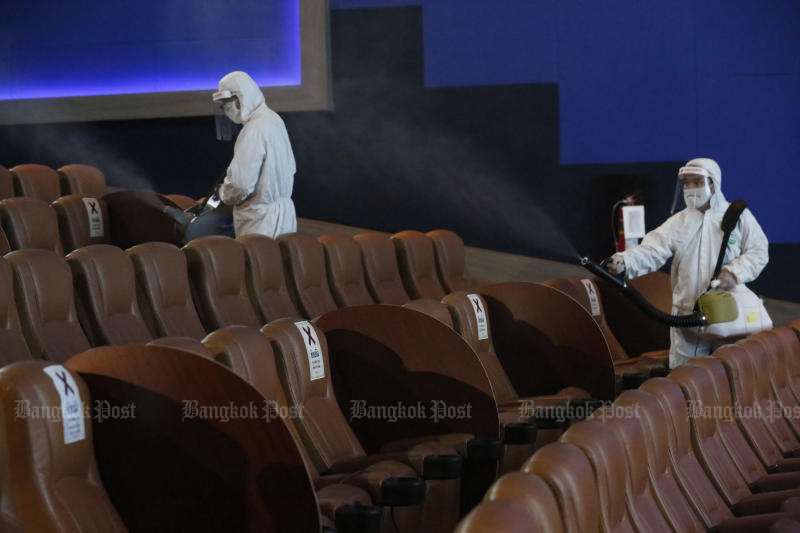 Cinema staff sanitise a theatre at Paragon Cineplex on Jun 1, 2020. Cinemas there are closed again from Sunday to Tuesday. (Photo by Pornprom Satrabhaya)