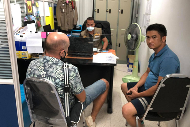 Dimas Frolova (left) gives information to police at Bo Phut police station after his estranged wife's body was found on Sunday. (Photo: Supapong Chaolan)