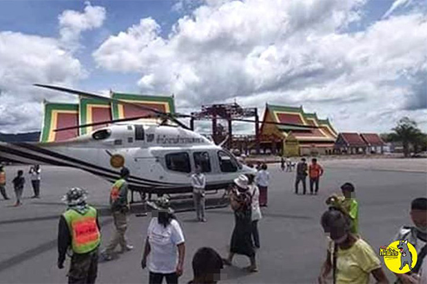 A Bell 419 of the Royal Thai Police Office lands at Wat Chedi in Sichol district of Nakhon Si Thammarat province on Friday. (Photo from @Watchdog.ACT Facebook account)