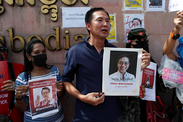 Supporters hold placards showing abducted activist Wanchalearm Satsaksit during a protest calling for an investigation, in front of the Cambodian embassy in Bangkok on Monday. (Reuters photo)