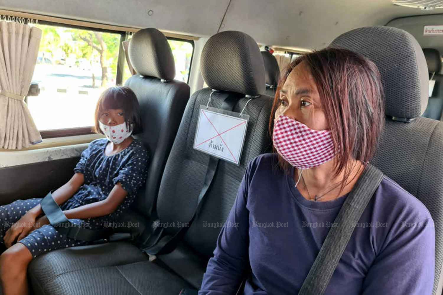 Interprovincial travellers are forced to comply with social distancing in a passenger van in Nakhon Ratchasima province on Wednesday. (Photo: Prasit Tangprasert)