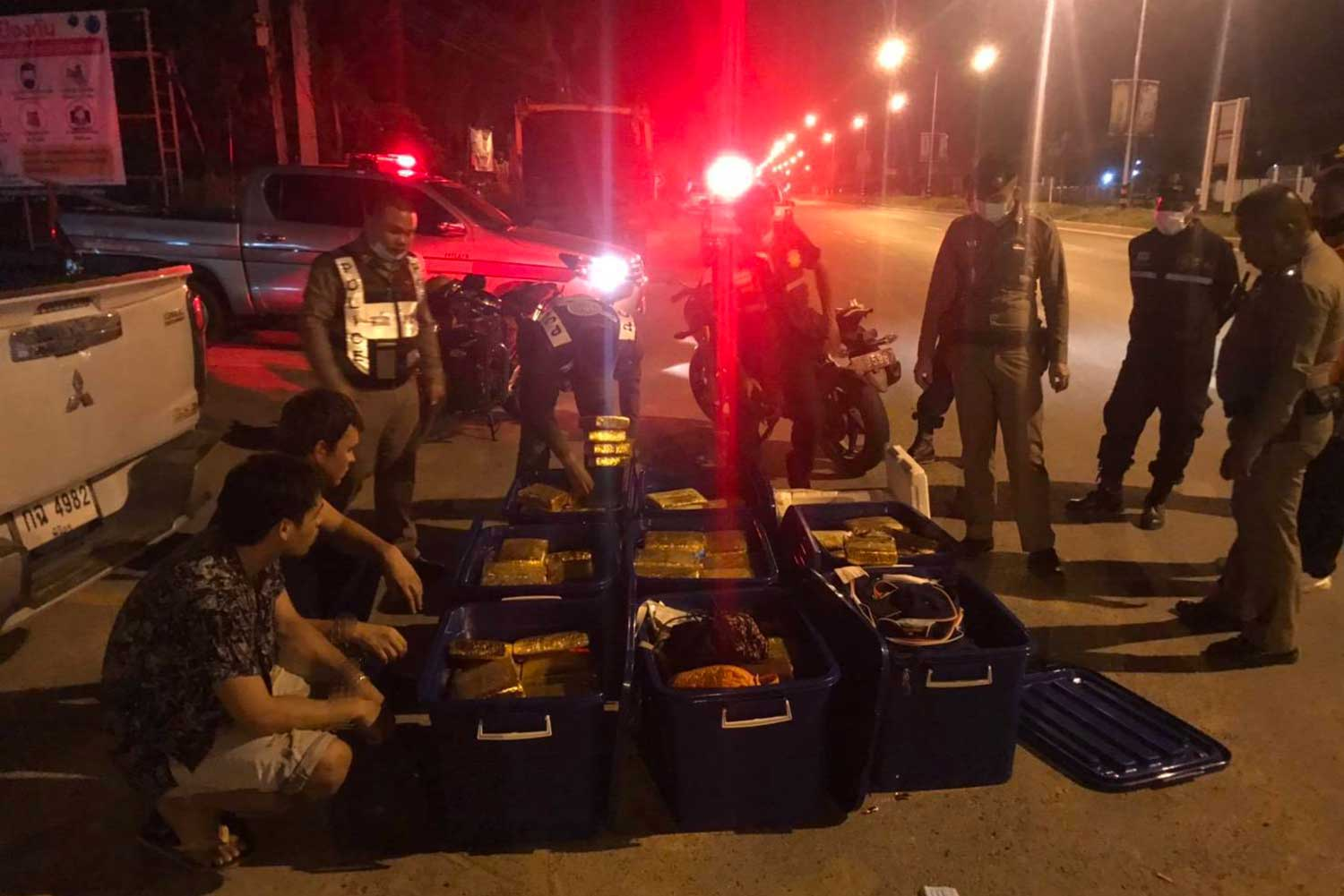 A Russian man and a Thai man are arrested after 296 packs of dried marijuana are seized from their pickup truck on May 9. (Photo supplied by Immigration Police)