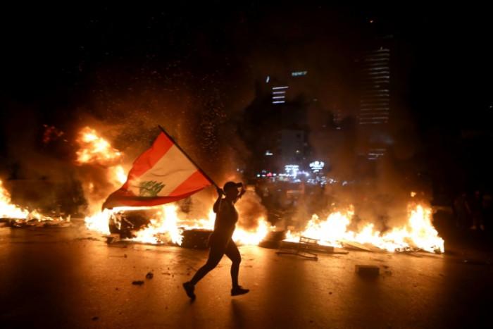 Lebanese pound hits new low despite govt efforts, sparking protests