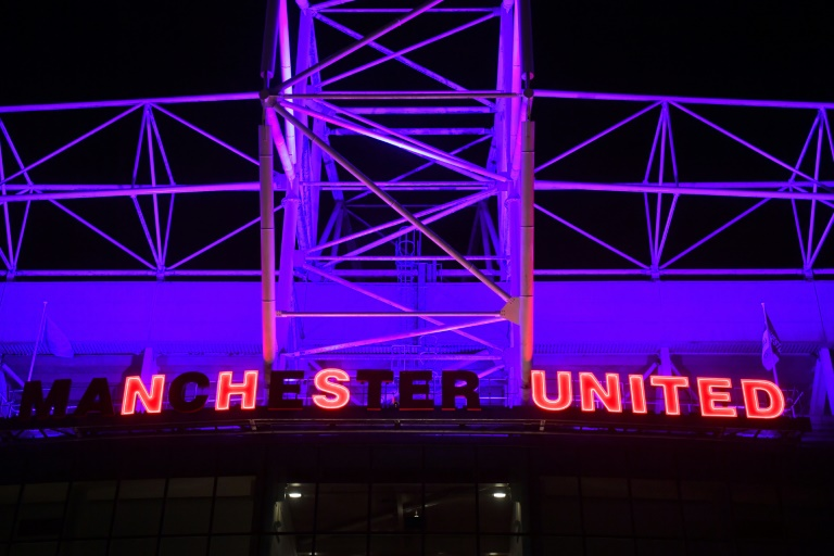 Lights at Manchester United's Old Trafford stadium pay tribute to Britain's National Health Service (NHS)