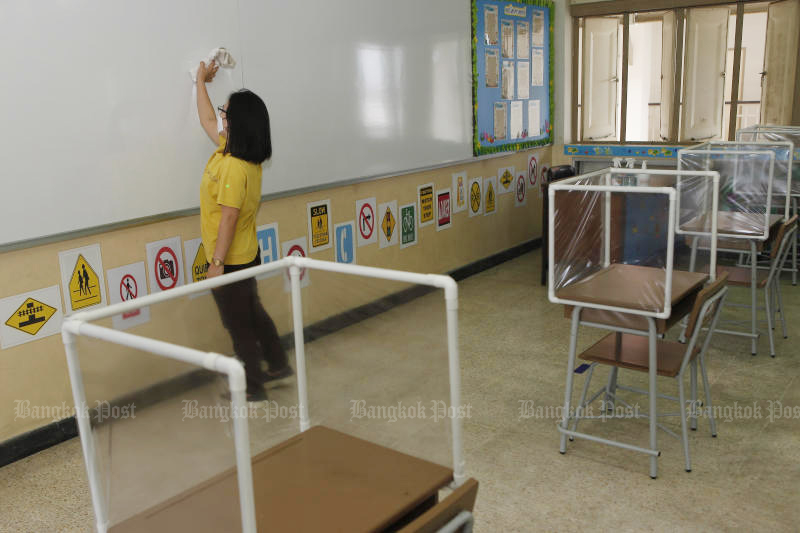 A staff member of Or-ngern School in Sai Mai district of Bangkok prepares for the reopening of classes halted by the coronavirus outbreak. (Photo by Nutthawat Wicheanbut)