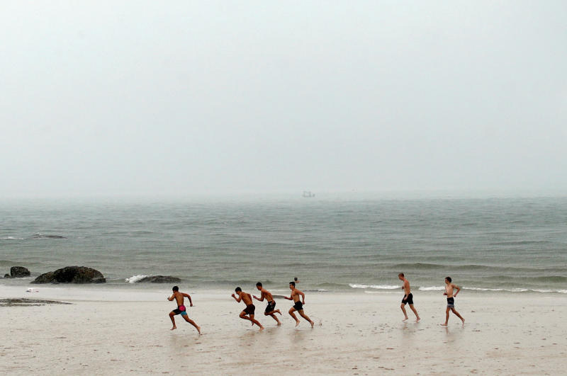 People play rugby on the beach in Hua Hin district of Prachuap Khiri Khan on Sunday. (Reuters photo)