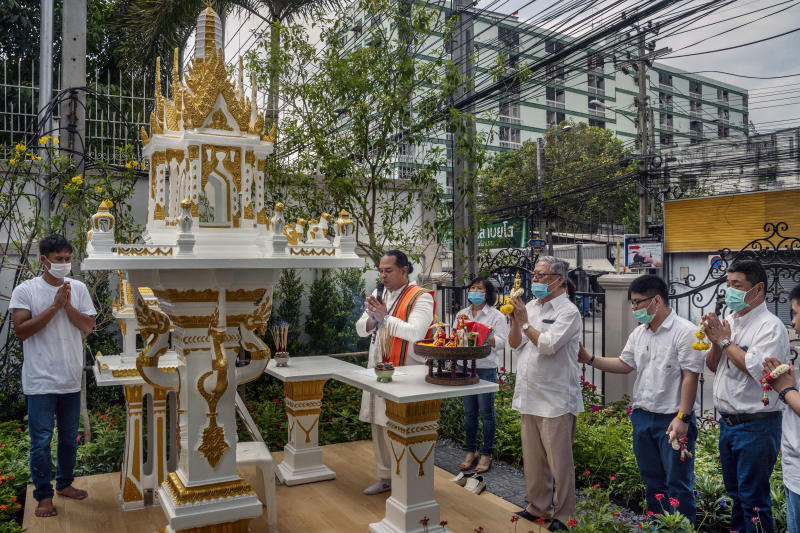 Kitsana Phattharasirisap, a spiritual consultant (centre), prays during a consecration ceremony for a spirit house at a new condominium complex in Bangkok, May 18, 2020. (Adam Dean/The New York Times)