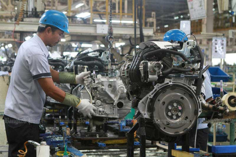 Workers in the auto sector are facing the threat of being replaced by artificial intelligence. (Photo by Somchai Poomlard)