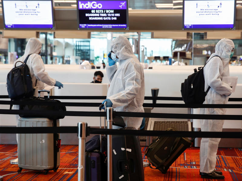 Seafarers who have spent the past months working onboard vessels arrive at the Changi Airport to board their flight back home to India during a crew change amid the coronavirus disease (COVID-19) outbreak in Singapore June 12, 2020. (Reuters file photo)