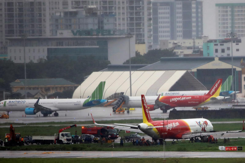 A VietJet Air passenger plane is seen on a grass field after skidding off the runway at Tan Son Nhat airport in Ho Chi Minh city, Vietnam on Sunday. (Reuters photo)