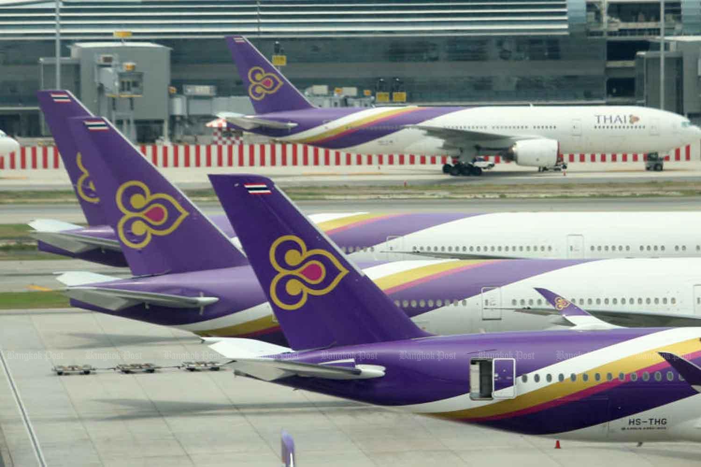 Thai Airways International airplanes sit on the tarmac at Suvarnabhumi airport.