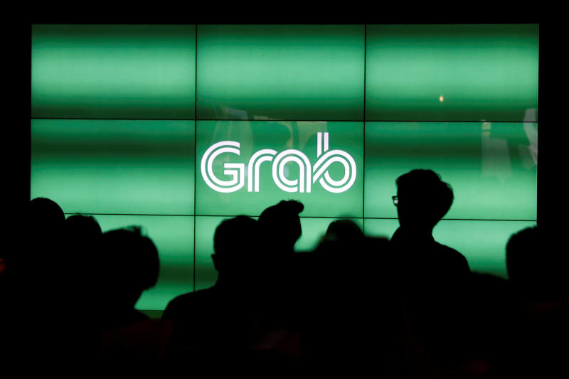 People wait for the start of Grab's fifth anniversary news conference in Singapore June 6, 2017. (Reuters file photo)
