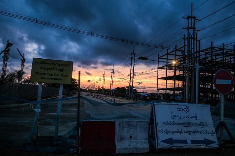Rain clouds linger over a construction site during the sunset in Yangon on June 3, 2020. (AFP photo)