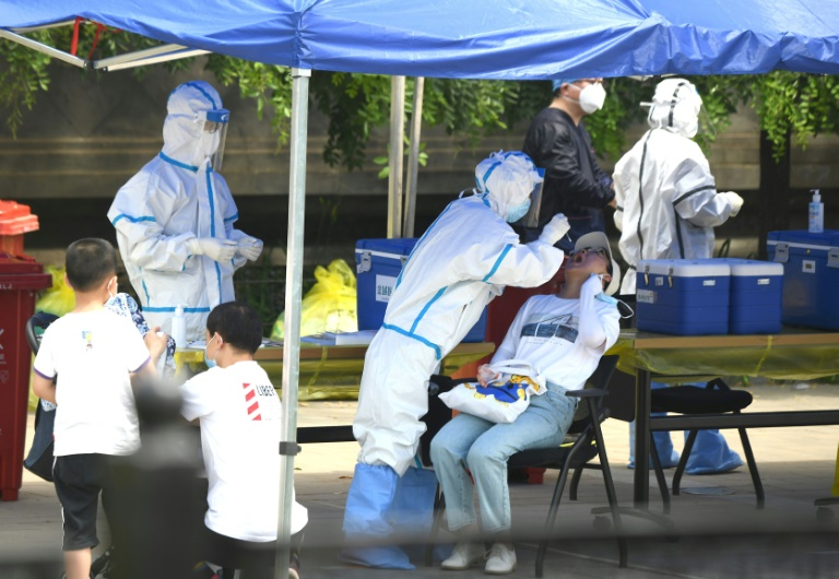 Chinese authorities are testing thousands of people as a new cluster of coronavirus cases sparks alarm.