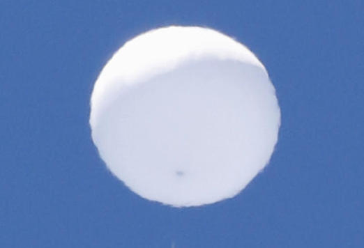 A balloon-like white object in the sky is pictured in Sendai, Japan on Wednesday. (Kyodo/via Reuters photo)