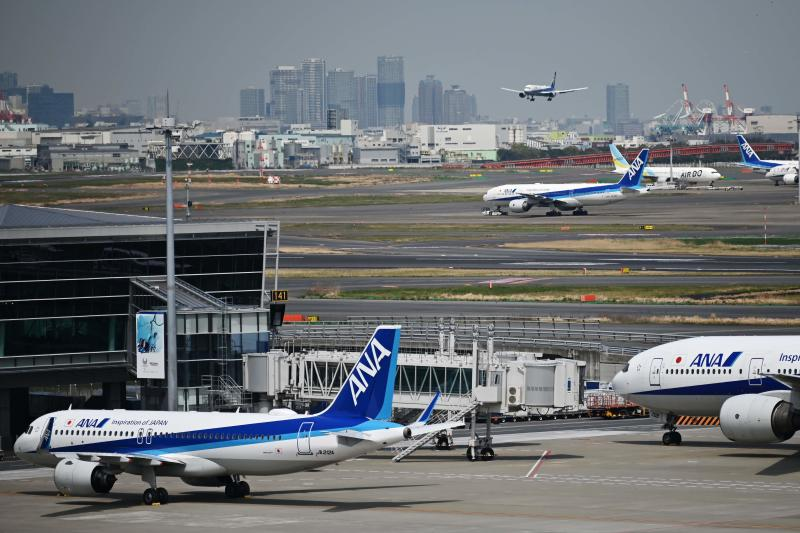 In this file photo taken on April 3, 2020 All Nippon Airways (ANA) aircraft are seen at Haneda Airport in Tokyo. (AFP)