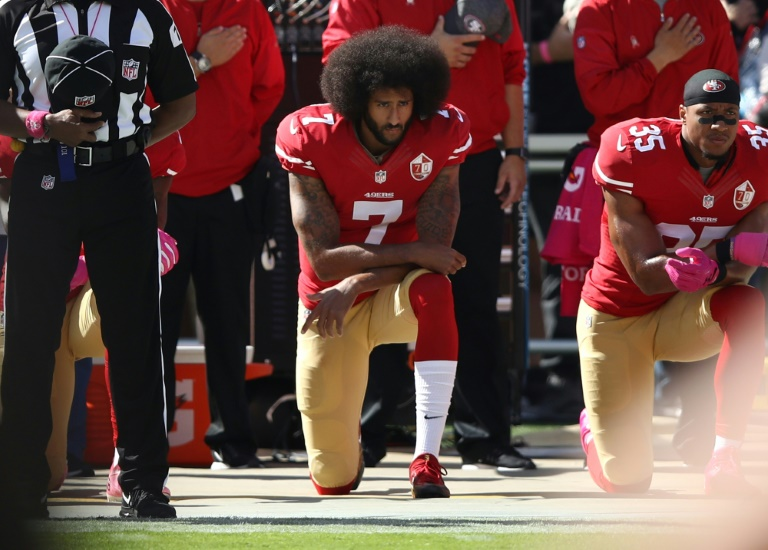 Donald Trump's comments on giving Colin Kaepernick (C) another shot comes after NFL commissioner Roger Goodell encouraged teams to sign the former San Francisco quarterback